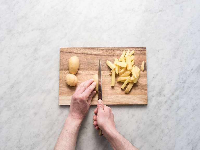 Preheat oven to 200°C/390°F. Cut potatoes into thin, French fry-shaped strips. In a large bowl, toss with olive oil, curry powder, ground nutmeg, and smoked salt. Transfer to a parchment paper-lined baking sheet and bake in preheated oven, turning occasionally, at 200°C/390°F for approx. 25 – 30 min. until crispy and golden.