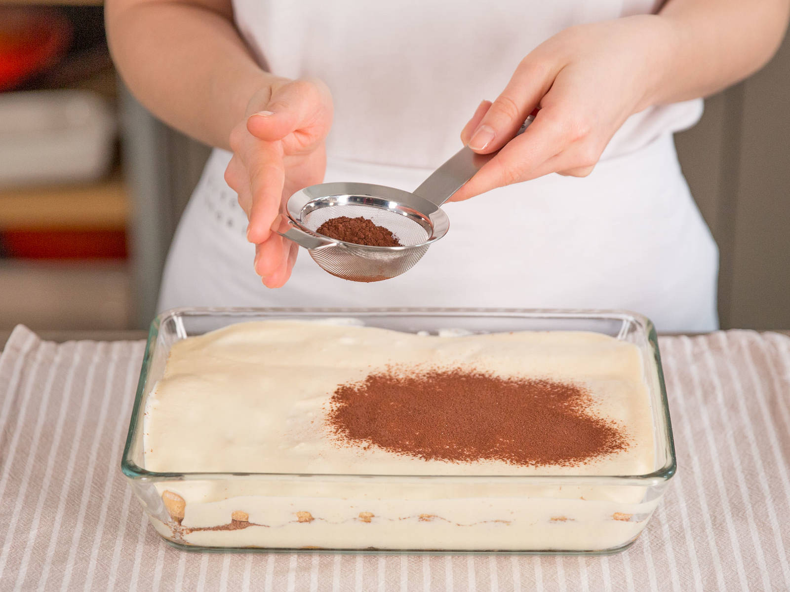Repeat layering process until all ingredients are used up. Finish up with a layer of mascarpone cream and dust with unsweetened cocoa powder. Refrigerate for at least 3 hours before serving.
