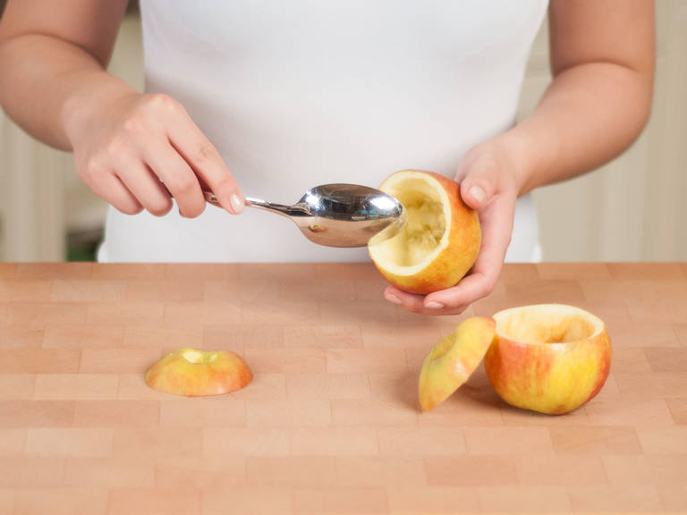 Preheat oven to 180°C/350°F. Cut off the top of each apple to form a lid. Scoop out the core with a spoon. Replace lids, place apples into a baking dish, and bake for approx. 10 – 15 min. Remove from oven.