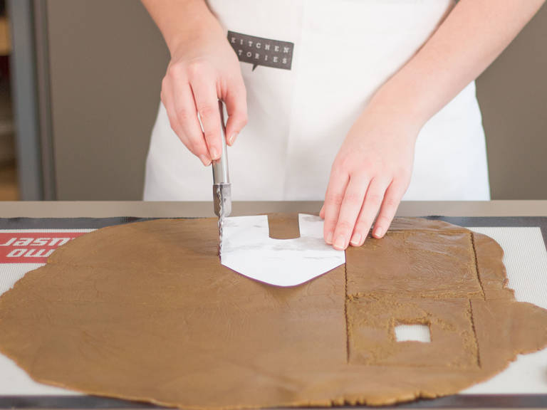 Preheat oven to 180°C/350°F. Flour work surface and roll dough out until approx. 1/2 finger thick. Using stencils (you will find them in the last step), cut out shapes needed for a gingerbread house. Cut Christmas tree shapes and gingerbread men out of remaining dough. Transfer to a lined baking sheet and bake in preheated oven for approx. 10 – 20 min., in batches if necessary. The pieces should be golden brown with a slightly firm surface. Transfer to a cooling rack.