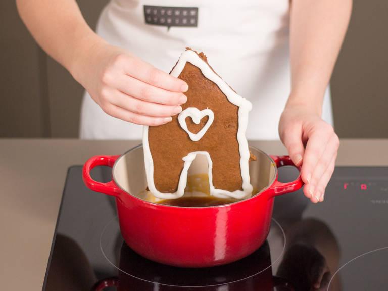 Zucker und etwas Wasser in einem kleinen Topf zu einem dunklen Karamell kochen. Unteren Rand der Platten jeweils vorsichtig in den Karamell tauchen und auf der Servierplatte festkleben. Mit Karamell die weiteren Nahtstellen wie auch die Weihnachtsbäume und Männchen festkleben.