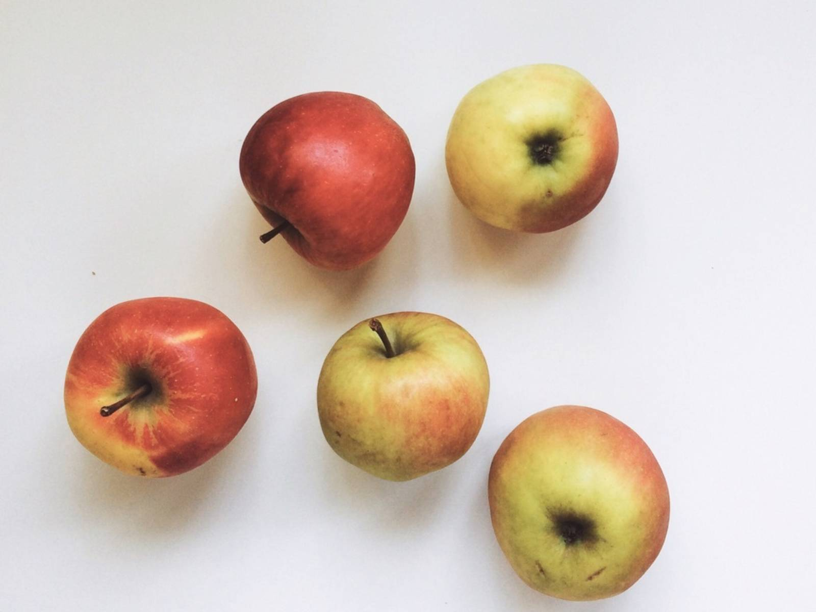 Wash and peel apples. Cut to personal preference—thin slices, for example. Fold into cake batter. Transfer batter to springform pan. Bake at 150°C/300°F (convection) for approx. 1 h. As baking time may vary from oven to oven, make sure you test cake for doneness. Insert wooden skewer into cake. If skewer comes out clean, cake is done. I serve it with caramel sauce and brittle.