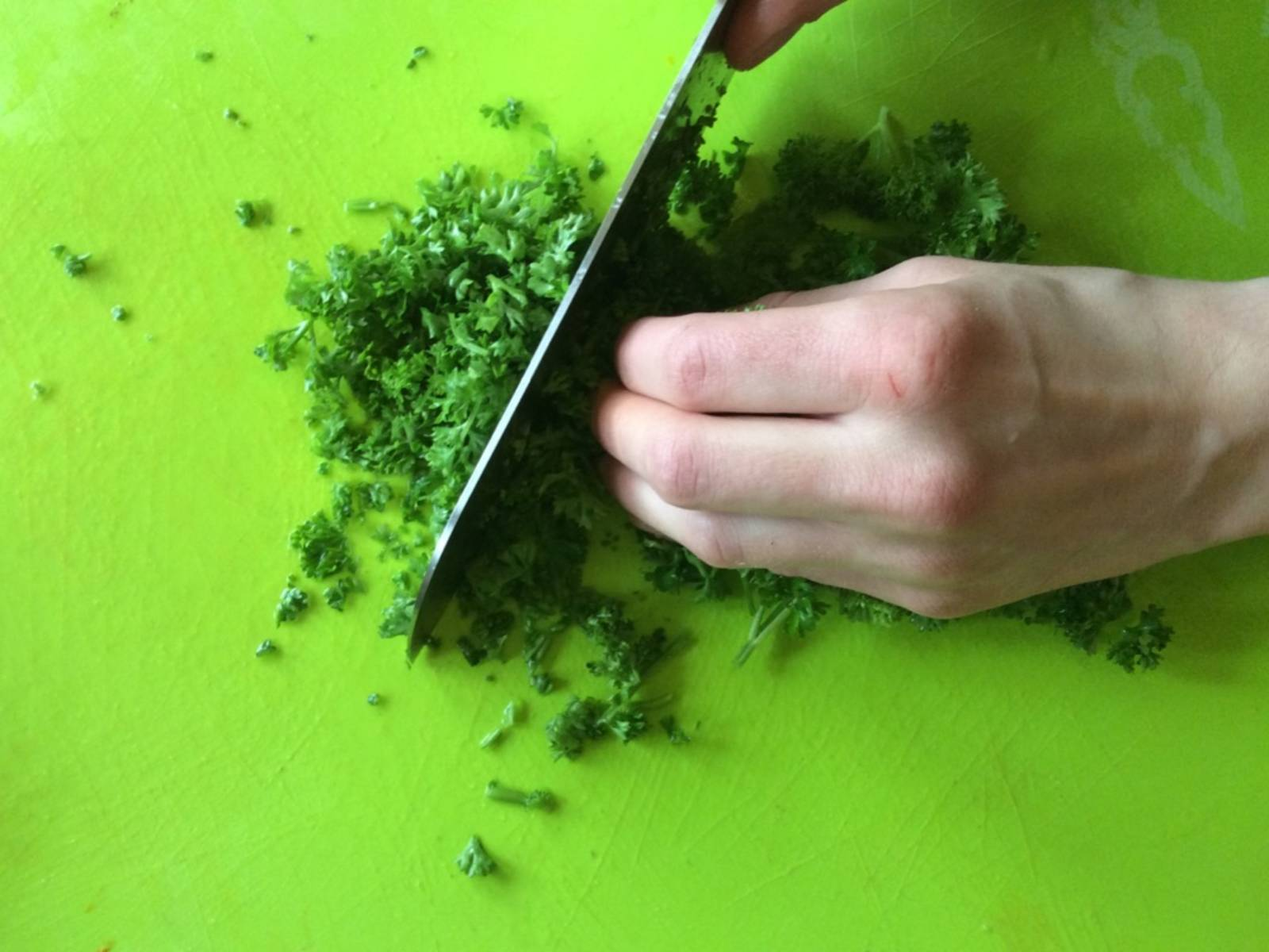 Finely chop parsley.