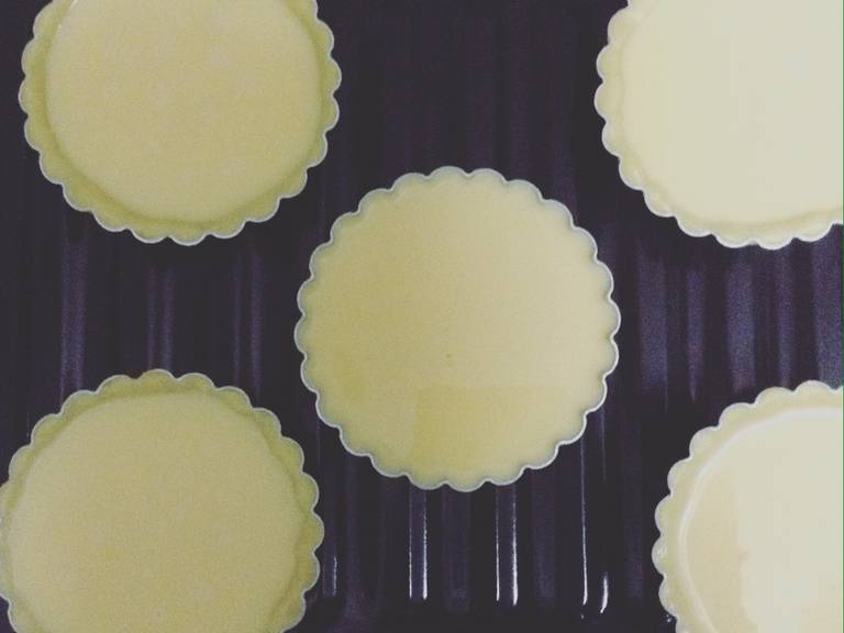 Roll out dough, and cut circles. Place in a greased muffin tin. Pour the egg filling inside.