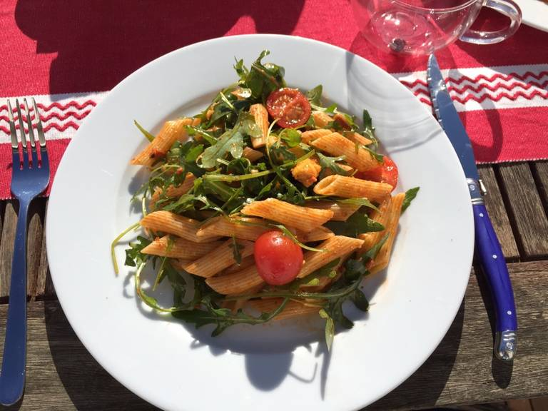 Combine all ingredients and serve immediately. If you want to prepare the pasta salad ahead but serve it later, add three quarters of the pesto and only add the rest and the arugula just before serving.
