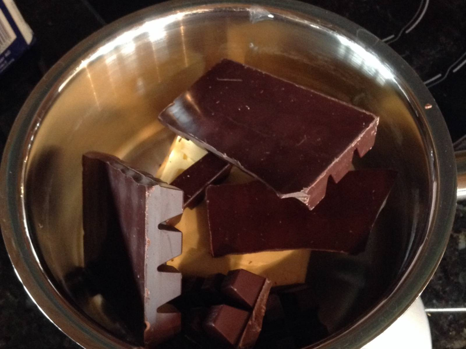 Pre-heat the oven to 175°C/350°F (convection). Melt chocolate and butter in a pan set over low heat. Stir occasionally to avoid burning. As the cake will be very sweet due to the large amount of sugar, I suggest you use very dark chocolate (with a high cocoa content).