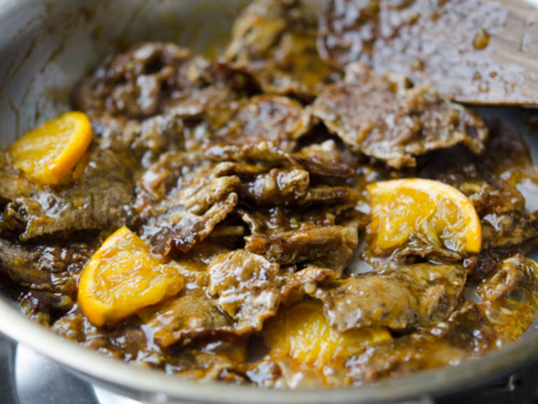 Add in the beef slices and the orange slices, toss well to coat with the sauce. Remove the skillet from the heat and serve immediately with rice.