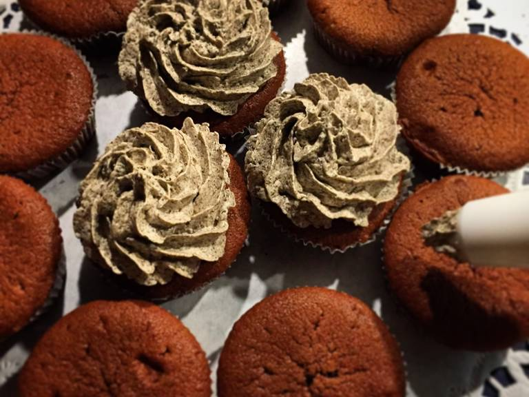 Fill cream into a piping bag and pipe onto each cooled cupcake with a large star-shaped decorating tip. If desired, decorate each cupcake with one or half an Oreo cookie.