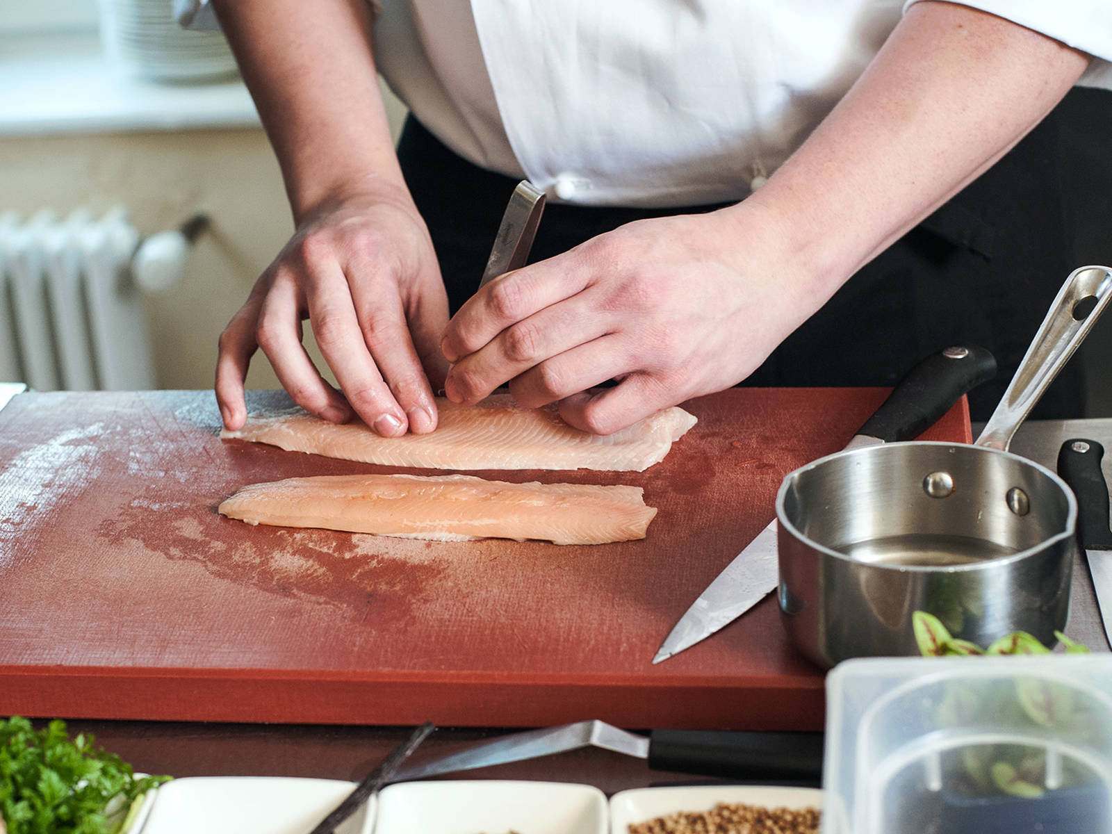 Fillet and remove bones from the arctic char.