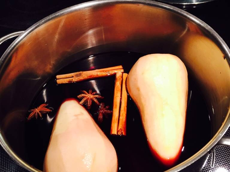 Peel the pears. Pour wine in a pot and add pears, sugar, cinnamon, and star anise.
