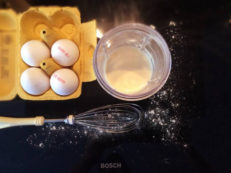 Beat the eggs. Add flour and mix well. Pour in milk, season with salt, and mix well. Set batter aside to rest for at least 15 min. or longer. Even a 24 hr. resting period would be fine.