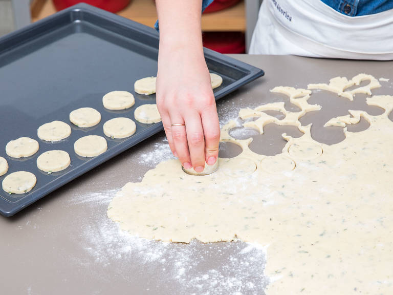 Flour a working surface and roll out the cooled dough, approx. 0.5-cm/0.2-in. thick. Use a cookie cutter to cut out circles to desired size. Transfer them onto a parchment-lined baking sheet.
