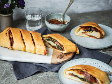 Spinach, salami, and mozzarella stromboli