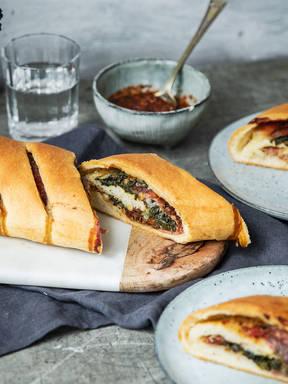 Spinach, salami, and mozzarella stromboli
