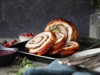 Crispy rolled pork belly with cranberries and herbs