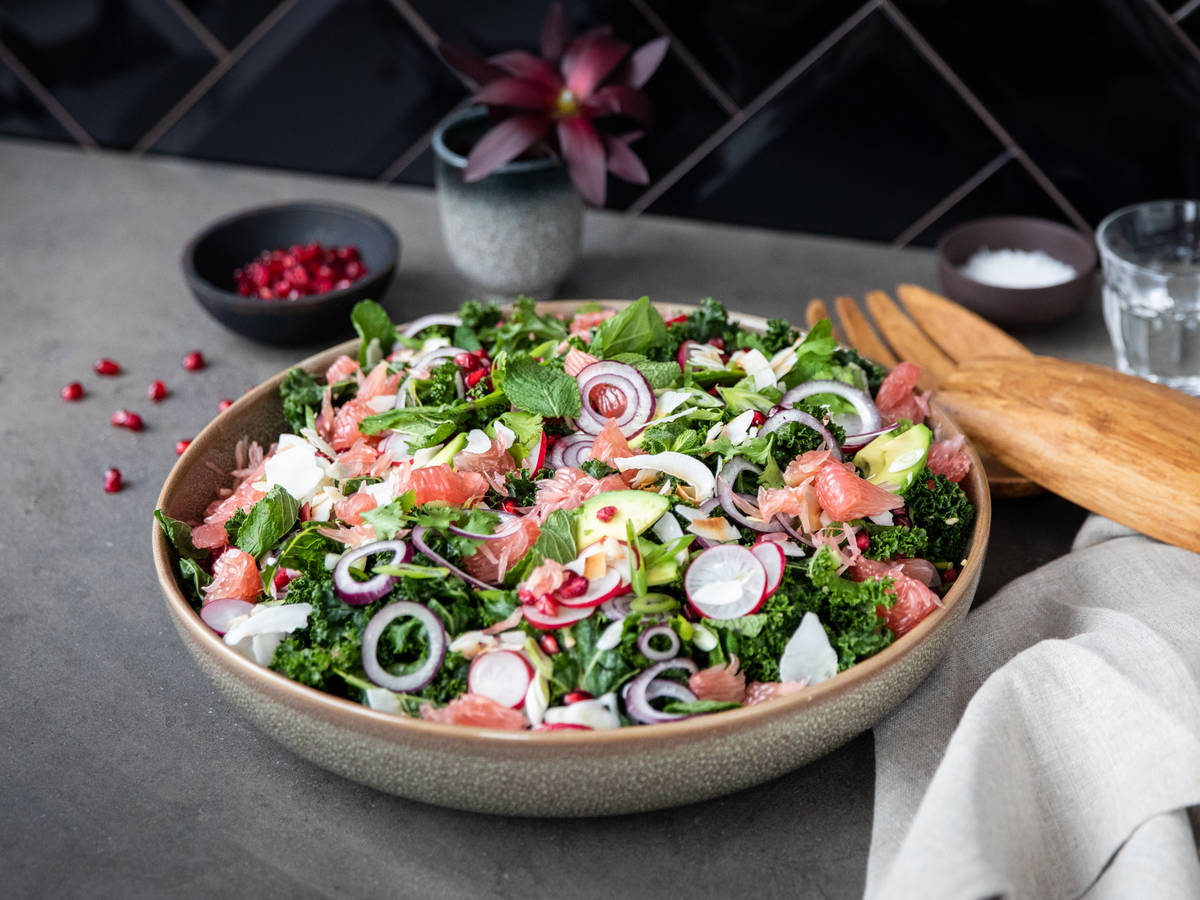 Pink pomelo salad with kale and avocado