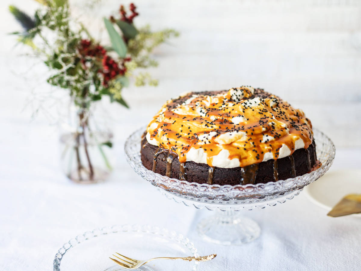 Chocolate cake with fluffy tahini frosting and salted caramel