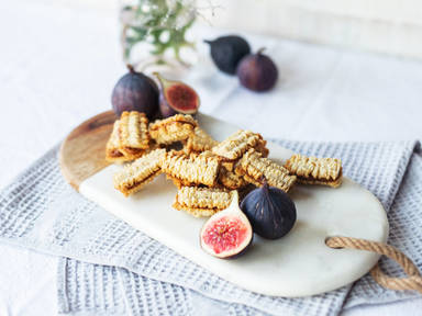 Walnut spritz sandwiches with fig-caramel filling