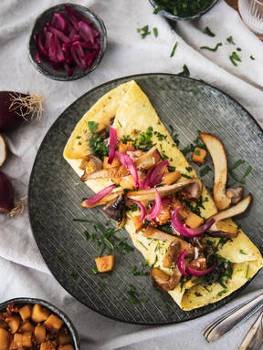 Porcini mushroom omelet with quince relish and pickled red onions