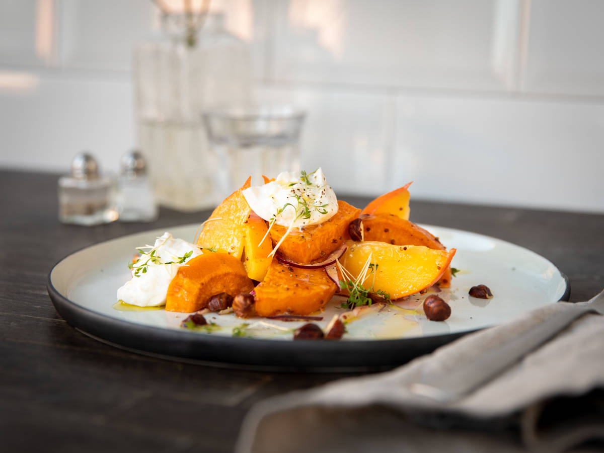 Roasted sweet potato salad with hazelnuts, persimmon, and burrata