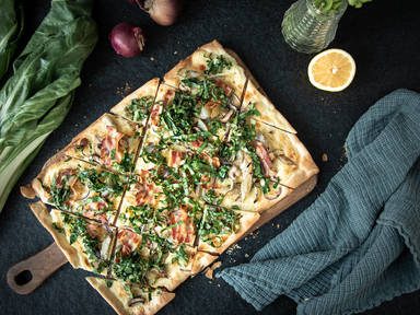 Tarte flambée with Swiss chard, mushrooms, and bacon