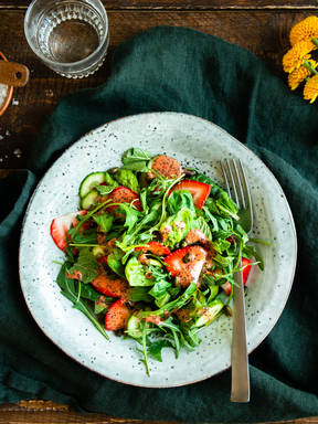 Green salad with strawberry-mustard dressing