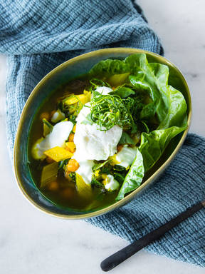 Swiss chard and chickpea stew with turmeric and poached eggs