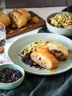 Savory potato and hazelnut strudel with braised cabbage and red wine sauce