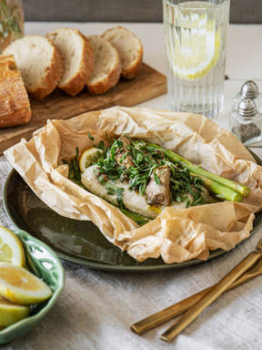 Parchment-baked fish with asparagus and artichokes