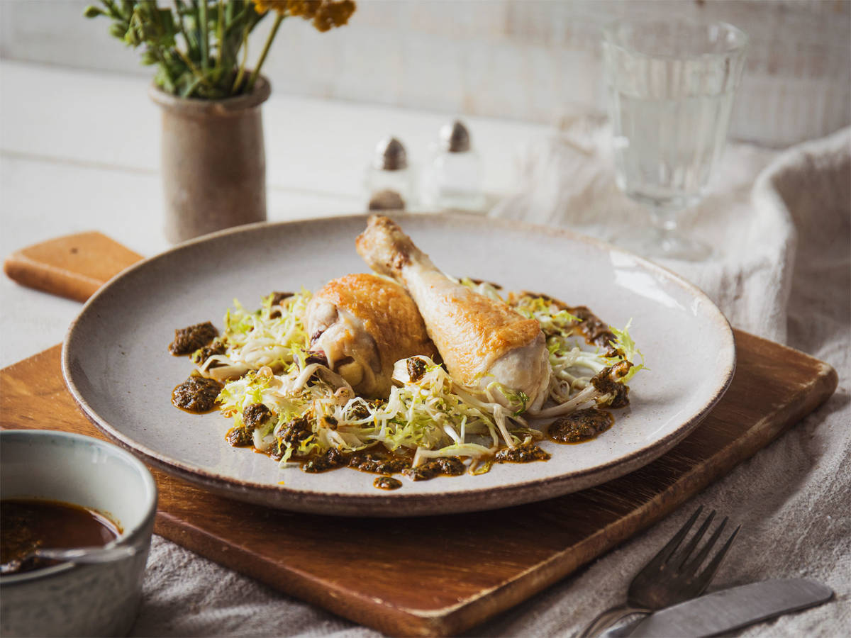 Crispy chicken with chermoula and wilted frisée
