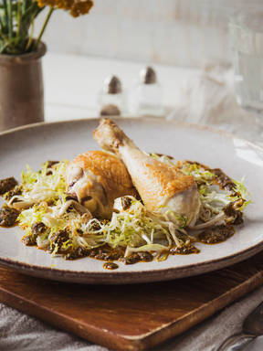 Crispy chicken with Moroccan-style sauce and frisée