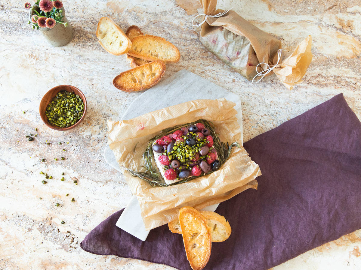Parchment-baked feta with raspberries and pistachios