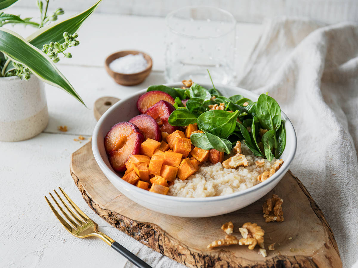 Sweet potato grain bowl with caramelized plums