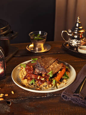 Roast leg of lamb with eggplant couscous
