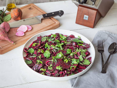 Simple beet carpaccio with mixed herbs
