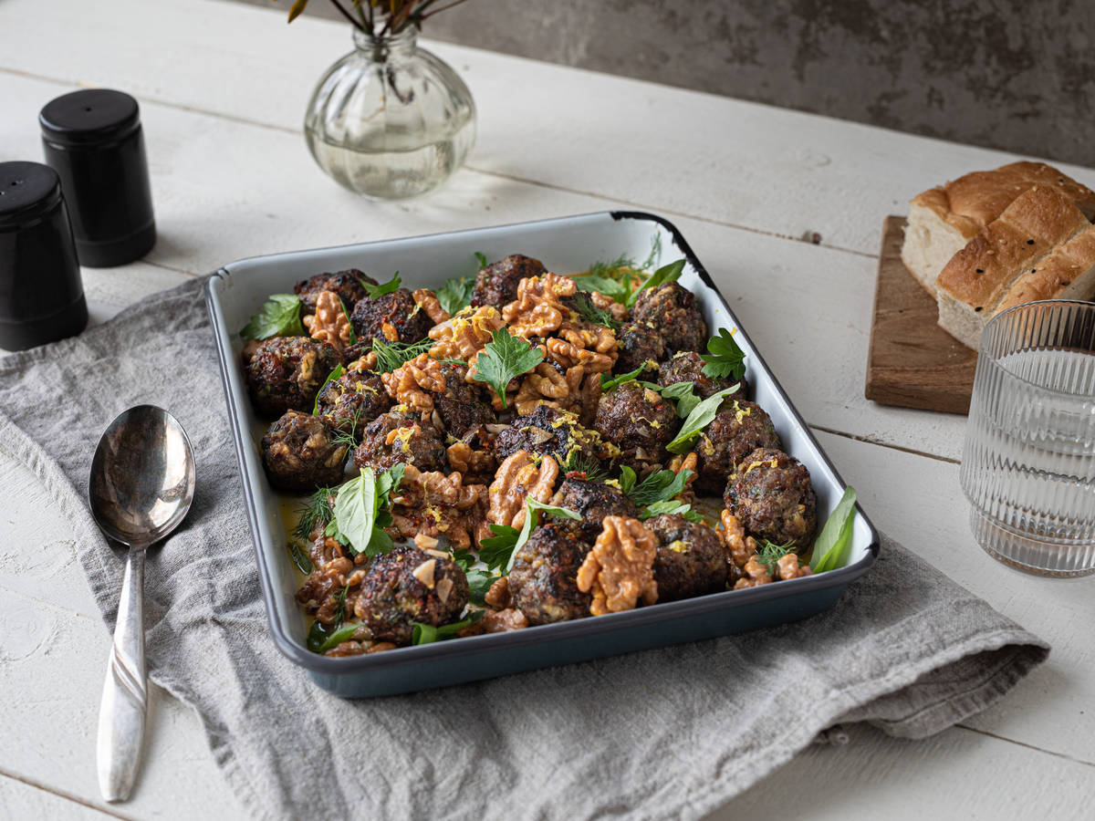 Easy sheet pan meatballs with savory walnut sauce