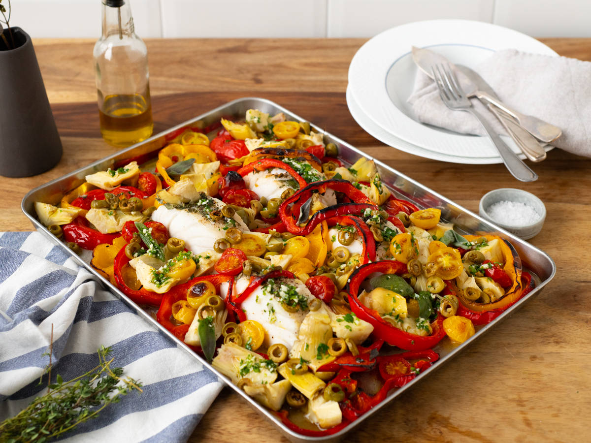 Provençal sheet pan fish with olives, tomatoes, and artichokes