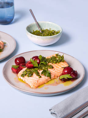 Parchment-baked salmon with sour cherries and parsley gremolata