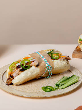 Grilled chicken banh mi with pickled carrots and daikon radish