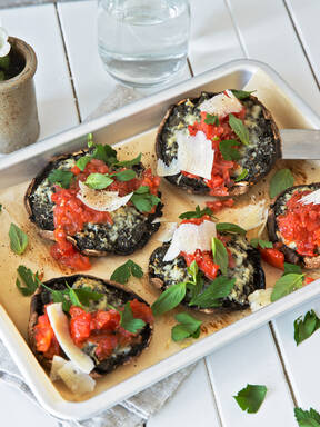 Stuffed portobello mushrooms with tomato ragù