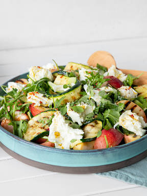 Summer salad with grilled peaches and zucchini