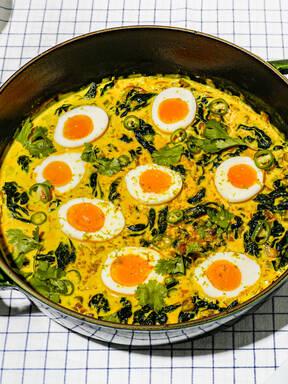 Jammy eggs and kale in turmeric-coconut gravy