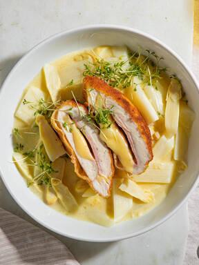 Chicken cordon bleu with creamy white asparagus