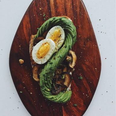 Bread with eggs and avocado