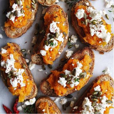 Mashed pumpkin and feta on bread