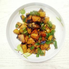 Stir-fried eggplant, potatoes, and peppers